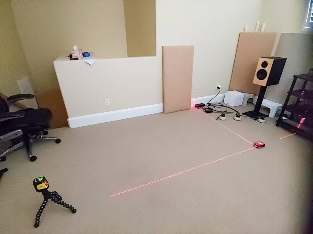 Illustrates using lasers to set up the grid